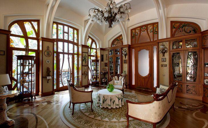 Просторная гостиная в стиле модерн. Изысканные плавные линии, отделка интерьера ценными породами дерева.Просторная гостиная в стиле модерн. Изысканные плавные линии, отделка интерьера ценными породами дерева.