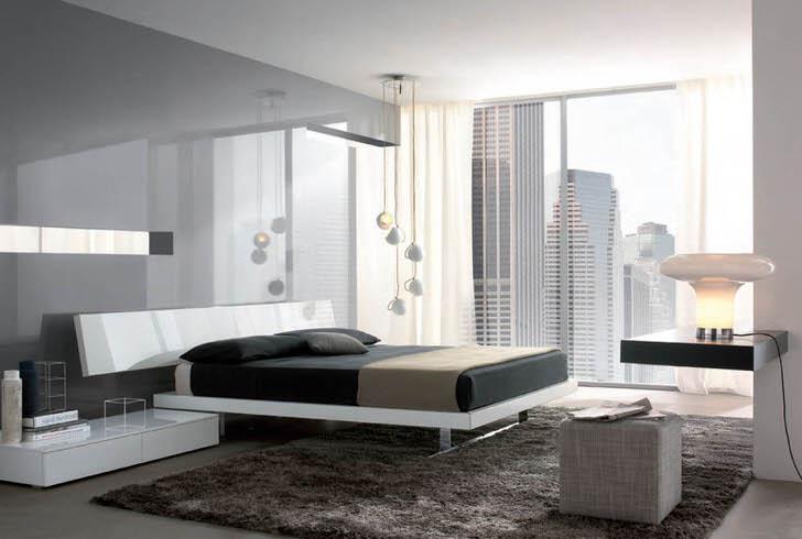Глянцевые поверхности с металлическим блеском делают спальную комнату хай-тек более просторной и светлой.