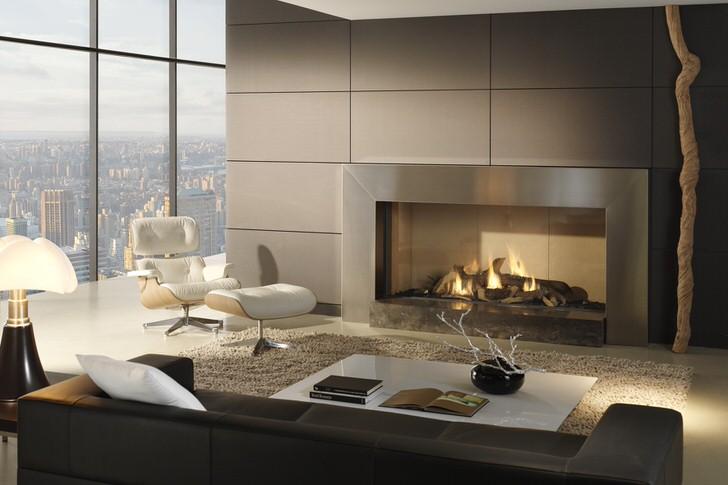 Современный камин гармонично вписывается в интерьер огромной студии небоскреба. Уютно и безопасно.