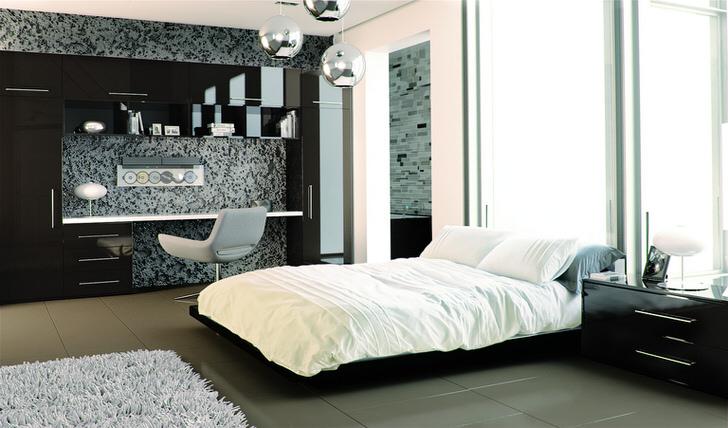 В оформлении спальной комнаты мебель с глянцевой поверхностью удачно сочетается с матовыми стенами.