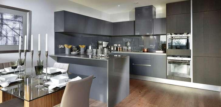 Стиль минимализм в интерьере большой кухни. Рабочая зона обозначена серым.