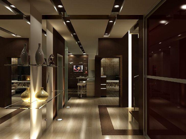 Стильная прихожая с интересным освещением. Осветительные блоки монтированы и в потолок, и в пол.