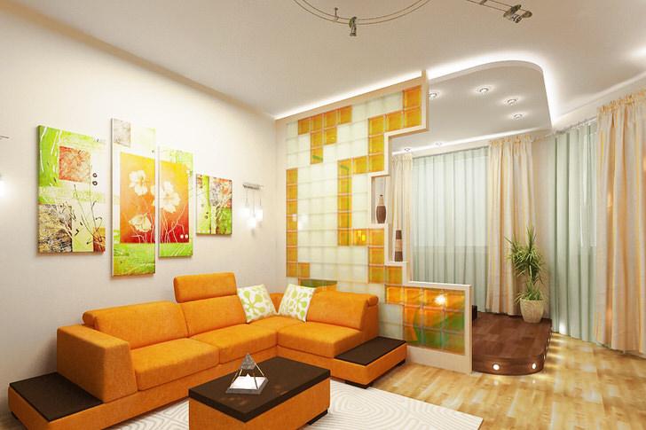 Яркая квартира-студия с зонированной панелями кухней.