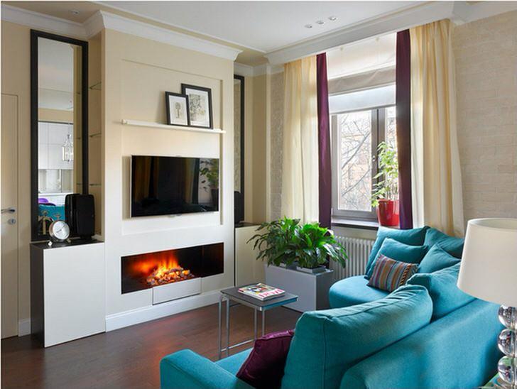 Встроенный в нишу фальш-стены вытянутый биокамин гармонирует с обстановкой и цветом гостиной.