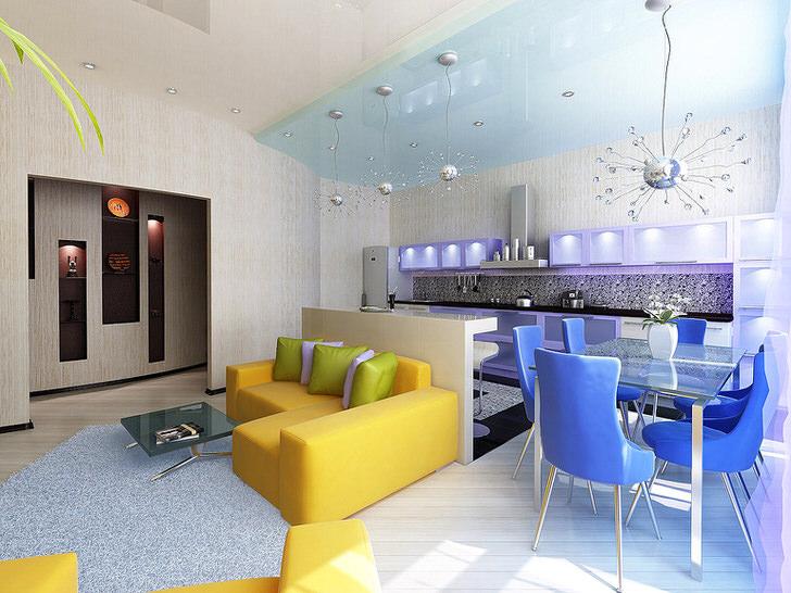 Квартира-студия в стиле Вау..., восхитительно. Кухня даже совсем к месту. Очевидно, что зоны разделены цветом.