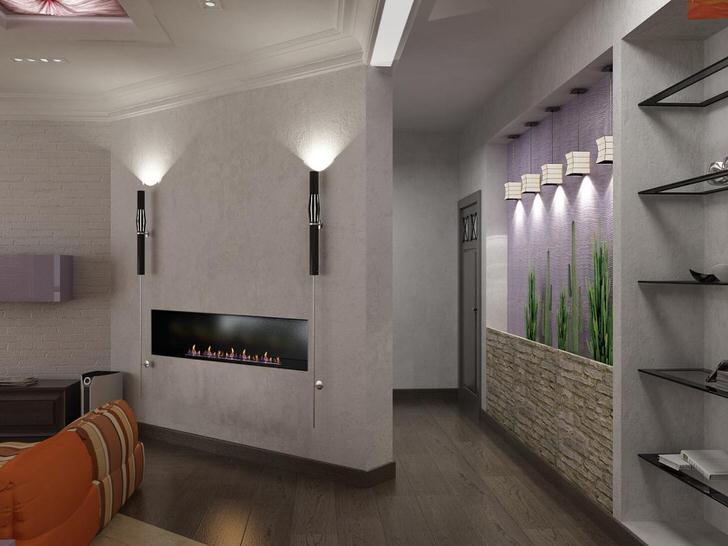 Встроенный в стену камин-свеча как элемент декора гостиной.