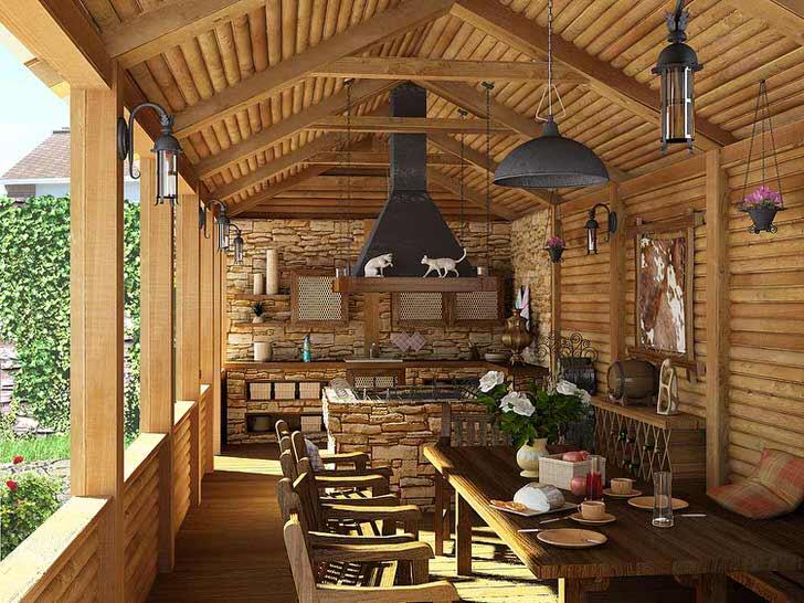 Небольшая кухня с мангалом на веранде загородного дома. О стиле кантри свидетельствует, в первую очередь, отделка стен и потолка деревянным срубом.