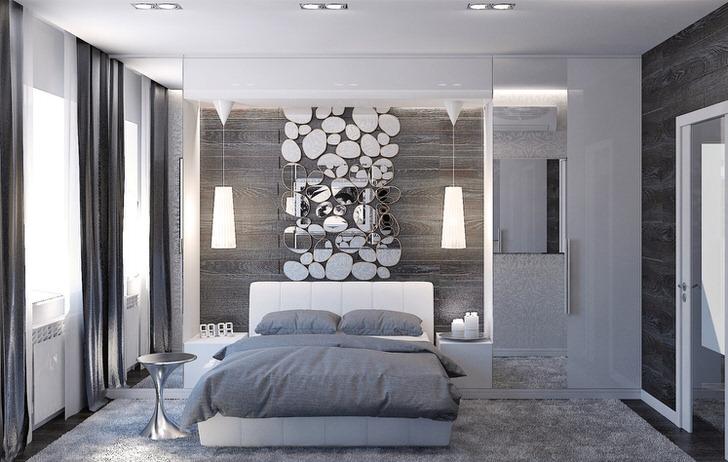Стена над изголовьем кровати декорирована стильным коллажем из зеркал овальной формы.
