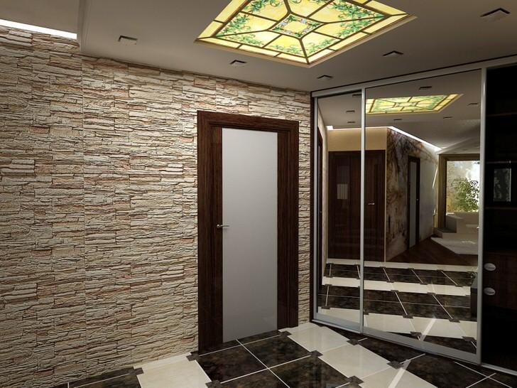 Стена из природного камня и полы, покрытые керамической плиткой, гармонично смотрятся в общей картине реализованного дизайнерского замысла.