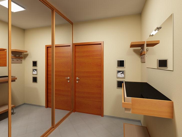 Небольшая, но светлая прихожая. Зеркальные дверцы большого шкафа-купе зрительно увеличивают пространство.