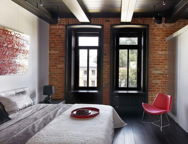 Удачное сочетание классики цвета-белое, красное, чёрное в интерьере спальни стиля лофт.