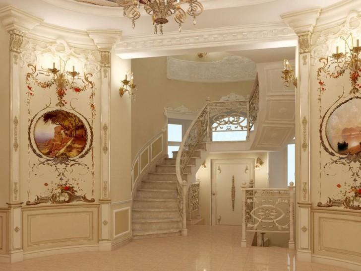 Контрастные старинные картины в интересной обработке и изысканная лестница в доме зажиточной французской семьи.