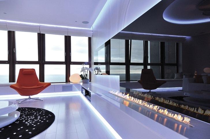 Камин-дорожка встраивается в интерьер просторного помещения. Популярен в оформлении современных холлов отелей.