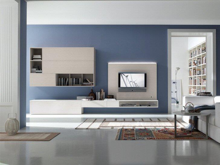 Мебель для интерьера в стиле хай-тек должна быть функциональной и стильной. Множество отделений, открытые полки в навесной части гарнитура для гостиной делают мебель вместительной.
