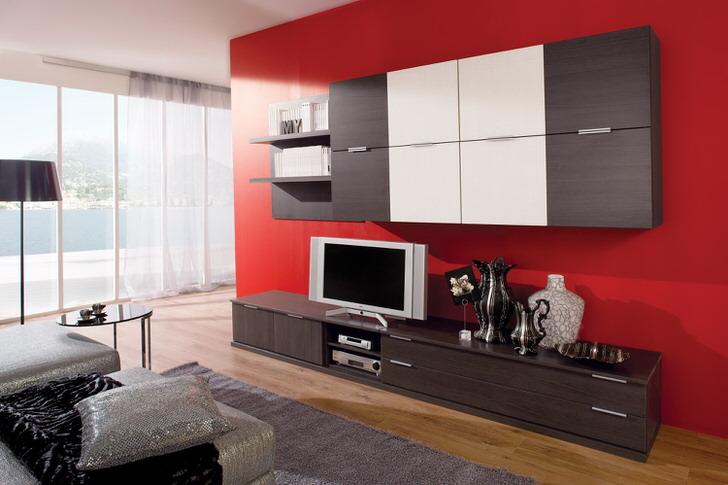 Модульная мебель для гостиной позволяет сэкономить пространство. Подвесные шкафы с множеством отделов позволяют не захламлять пространство.
