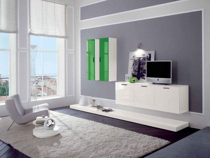 Лаконичное оформление гостевой комнаты выполнено в стиле модерн. Уюта и тепла атмосфере добавляет ковер с высоким ворсом.