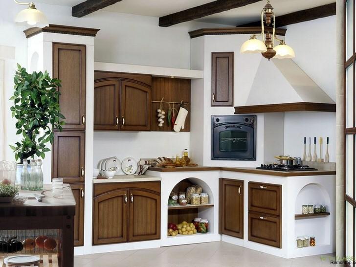Выгодное сочетание белого цвета и цвета темного дерева на кухне в стиле кантри. Печка с вытяжкой внешне напоминает печь из сказок, которые нам в детстве читали родители.