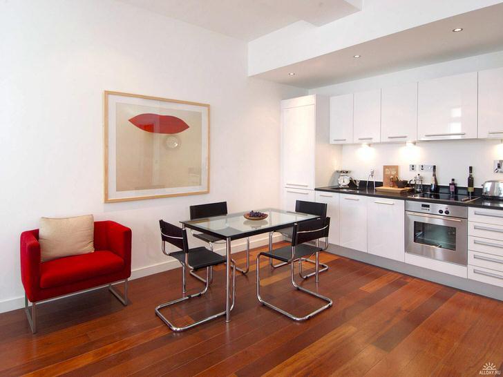 Стильная кухня с акцентами красного. Минималистический стиль беспроигрышный вариант для оформления квартир-студий.