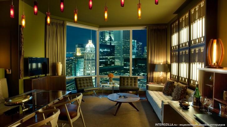 Необычная дизайнерская идея для гостиной в модерн стиле воплощена в жизнь с использованием множества потолочных люстр с приглушенным свечением.