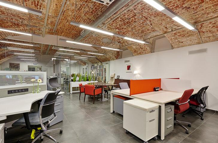 Оформление в стиле лофт офиса крупной компании, как удачный пример соблюдения концепции стиля.