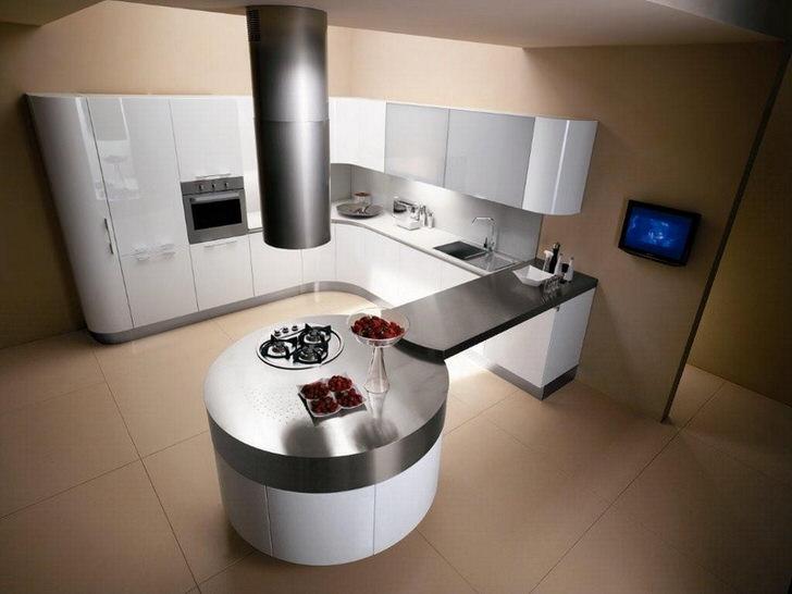 Кухня в стиле минимализм отличается использованием четко очерченных геометрических форм. Данный проект примечателен круглым обеденным столом, объединенным столешницей с кухонным гарнитуром.
