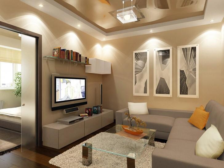 Натяжные потолки бежевого и белого цвета изысканно смотрятся в современной гостиной.