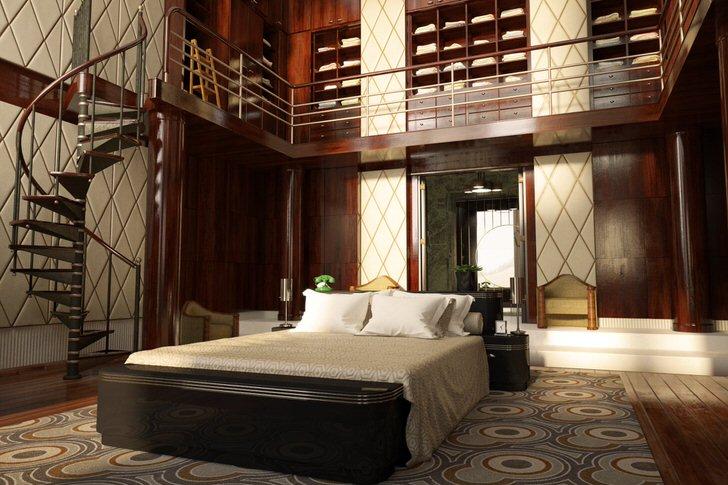 Спальня с высокими потолка оформлена достаточно эффектно. Пространство организовано функционально и просто. Винтовая лестница ведет к внушительному гардеробу.