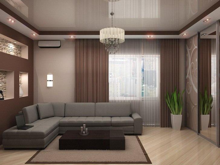 Серо-бежевый потолок в два яруса органично вписывается в стильную комнату для гостей.