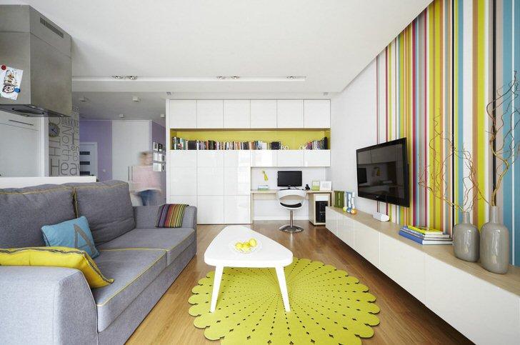 Яркий, креативный дизайн гостиной, совмещенной с кухней, в квартире-студии.