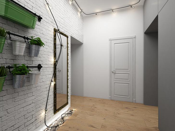 Пример удачного освещения для прихожей в стиле лофт. Множество ламп объединились в одной гирлянде.