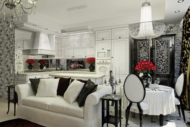 Кухня-гостиная в стиле арт деко с белым гарнитуром и встроенной техникой.