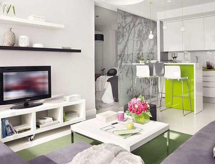 Оформление небольшой квартиры-студии должно быть функциональным. В обустройстве интерьера использовано множество полочек, которые позволяют практично использовать пространство.