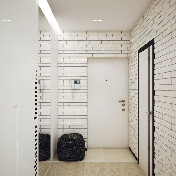 Кладка из белого кирпича использована для оформления прихожей в лофт стиле. Интересным дизайнерским решением становится большое зеркало без рамок и обрамления.