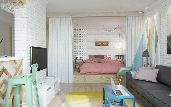 Скандинавский стиль подходит для оформления квартир студии. В большой гостиной можно при помощь тканевой ширмы выделить зону отдыха, поместив кровать в своеобразную нишу.