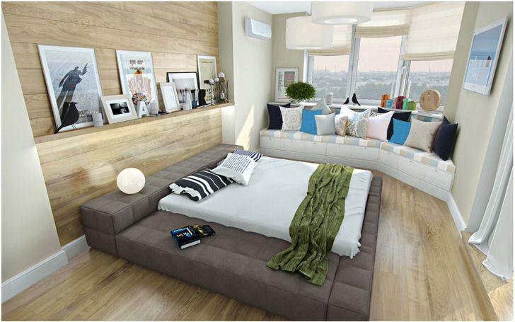 Интересным решением для спальни в скандинавском стиле является небольшой диванчик под окном, украшенный яркими подушками.