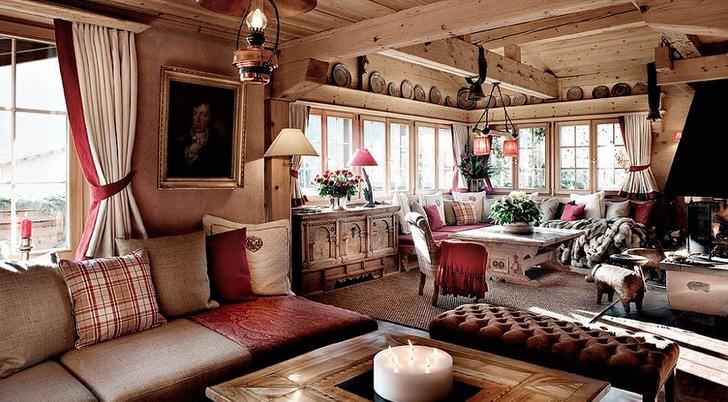 Акценты красного цвета в комнате в стиле шале делают комнату романтической и эстетически привлекательной.