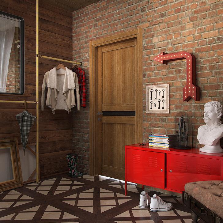 """Стиль лофт """"не любит"""" много мебели. В качестве шкафа можно использовать конструкцию из труб, для хранения обуви отлично подойдет металлическая тумба ярко-красного цвета."""