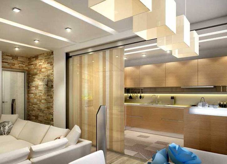 Декоративная, выдвигающаяся перегородка отделяет кухню от гостиной. Практичное решение для просторной квартиры.