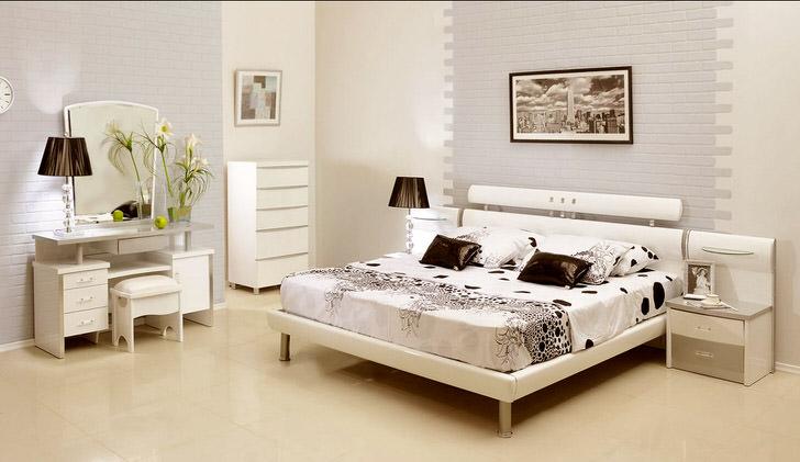 Интерьер гостевой спальни в загородном доме спланирован в стиле модерн.