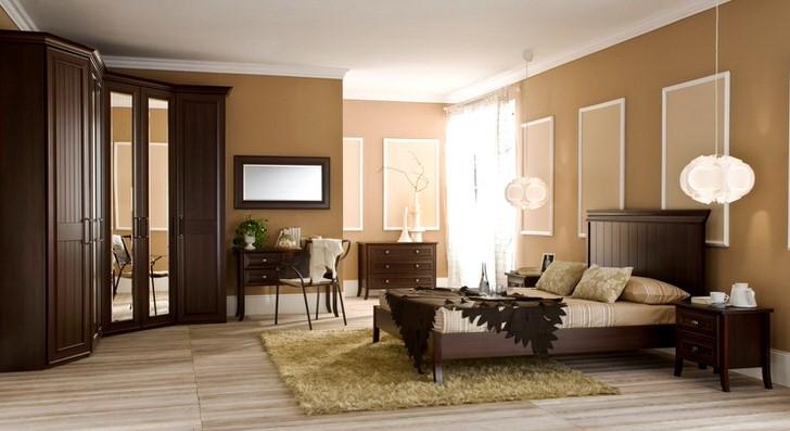 Гарнитур для спальни выполнен в цвете венге. Огромный шкаф вместителен и занимает минимум места благодаря своей L-образной форме.