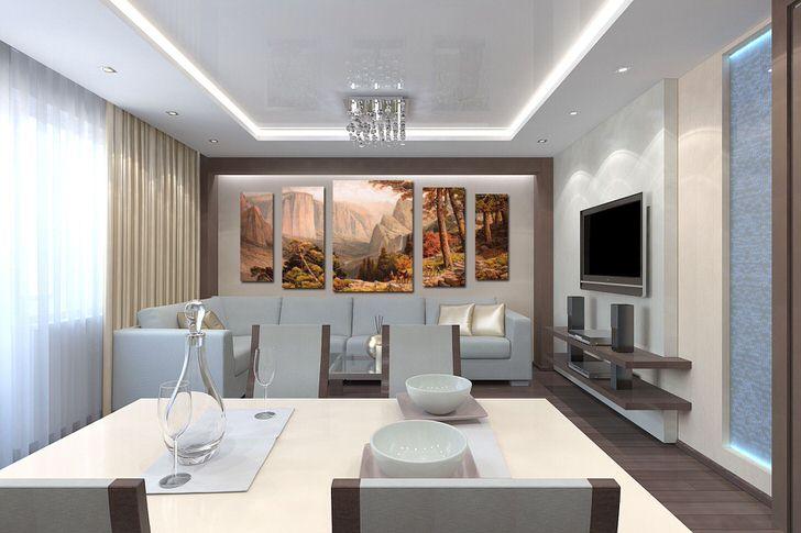 Стена над диваном украшена большими модульными картинами с изображением осеннего пейзажа. Теплые оттенки желтого делают атмосферу уютной.