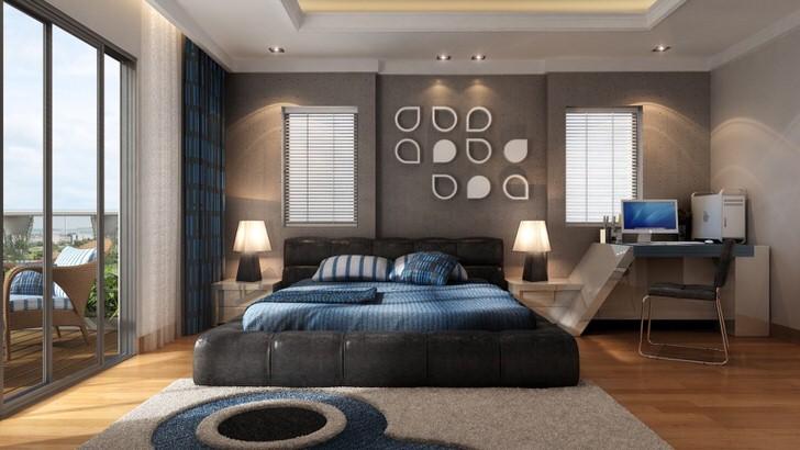 Огромная кровать, выполненная в виде подиума, смотрится необычно в спальне в стиле модерн.