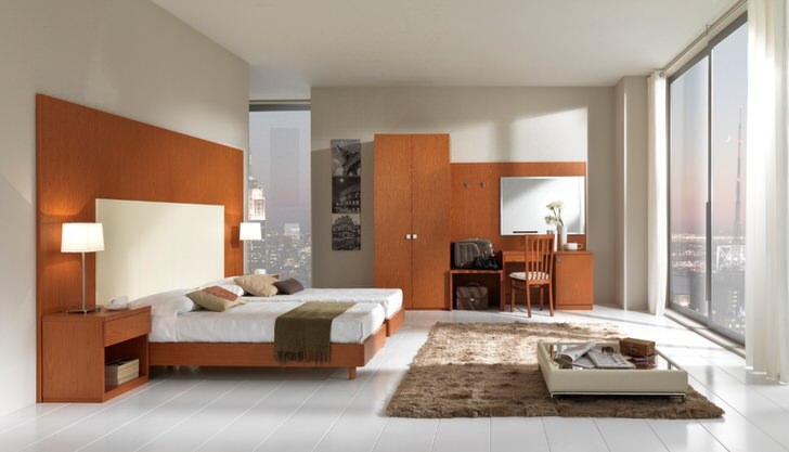Лаконичное оформление спальни в стиле модерн.