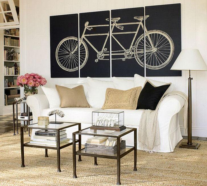 Гостиная в скандинавском стиле украшена модульными картинами с изображением велосипеда. Не перегруженный смыслом рисунок делает дизайн завершенным.