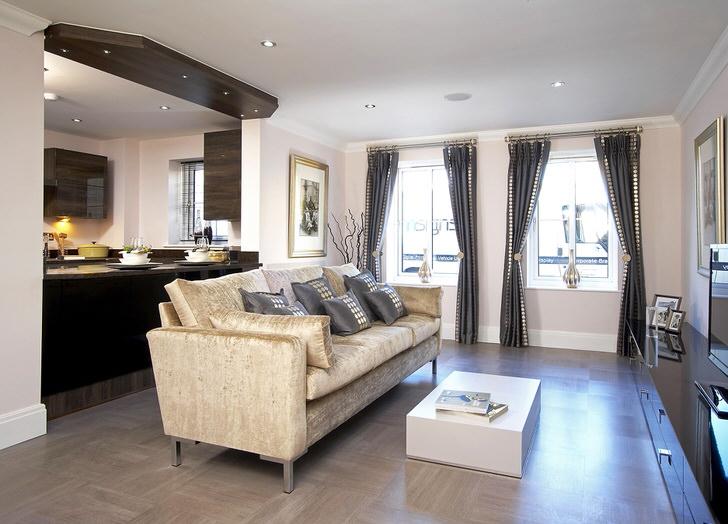Сдержанный интерьер кухни-гостиной подобран в соответствии с требованиями к оформлению небольшой квартиры.