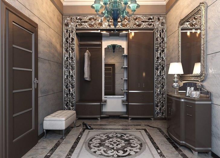Прихожая в стиле арт деко в темных тонах оформлена в соответствии с грамотным дизайнерским проектом, разработанным для дома испанского предпринимателя.