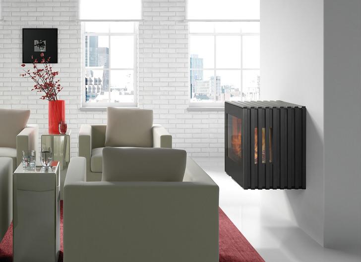 Настенный подвесной камин в имитацией пламени идеально дополняет интерьер в стиле лофт.
