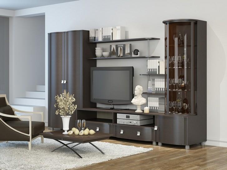 Стильно решение для гостиной. Мебель цвета венге сочетается ламинатом, имитирующим дерево.