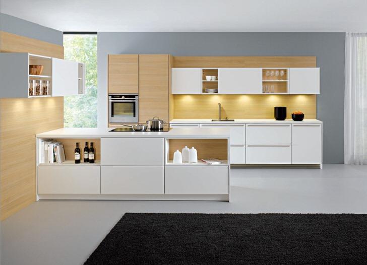 Классическим сочетанием на кухне считается сочетание белого и светло-бежевого цвета. Отсутствие фурнитуры делает гарнитур пригодным для оформления кухни в стиле хай-тек или минимализм.