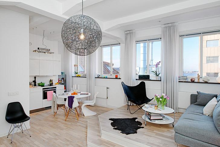 Квартира-студия размером 40 кв. м. оформлена в скандинавском стиле.